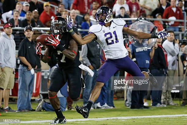 Wide receiver Ty Montgomery of the Stanford Cardinal catches the ball for a touchdown as defensive back Marcus Peters of the Washington Huskies...
