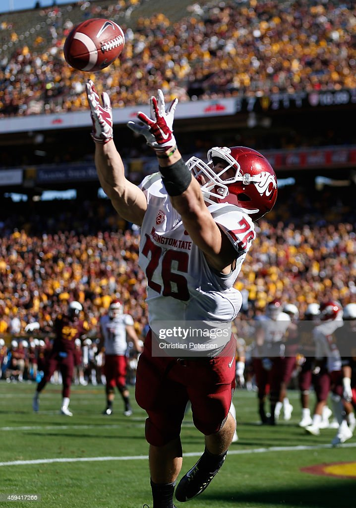 Wide receiver Tyler Baker of the Washington State Cougars is unable to catch the football in the endzone during the second quarter of the college...