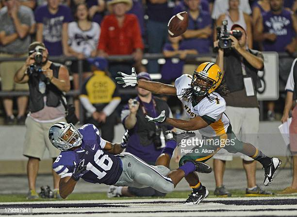 Wide receiver Tyler Lockett of the Kansas State Wildcats dives for a pass against defensive back Marcus Williams of the North Dakota State Bison...