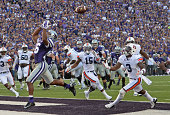 Wide receiver Tyler Lockett of the Kansas State Wildcats has the pass deflect off his helmet as defensive back Jonathan Jones of the Auburn Tigers...