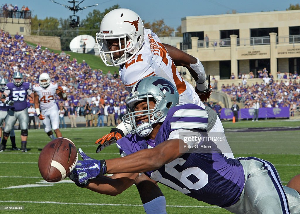 Wide receiver <a gi-track='captionPersonalityLinkClicked' href=/galleries/search?phrase=Tyler+Lockett&family=editorial&specificpeople=8364808 ng-click='$event.stopPropagation()'>Tyler Lockett</a> #16 of the Kansas State Wildcats makes a diving attempt for a pass against defensive back Duke Thomas #21 of the Texas Longhorns during the first half on October 25, 2014 at Bill Snyder Family Stadium in Manhattan, Kansas.