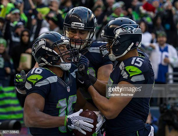 Wide receiver Tyler Lockett of the Seattle Seahawks celebrates scoring a touchdown with wide receiver Jermaine Kearse of the Seattle Seahawks and...