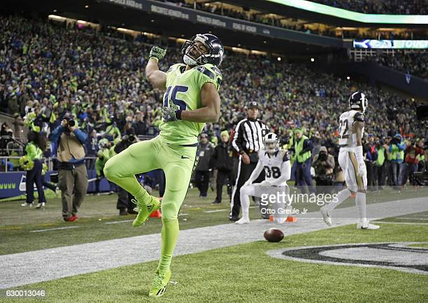 Wide receiver Tyler Lockett of the Seattle Seahawks celebrates after scoring a touchdown against the Los Angeles Rams at CenturyLink Field on...