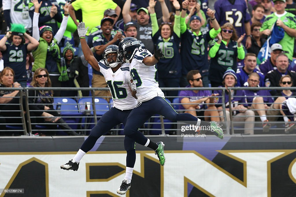 Wide receiver Tyler Lockett #16 of the Seattle Seahawks celebrates with teammate wide receiver Doug Baldwin #89 after scoring a fourth quarter touchdown against the Baltimore Ravens at M&T Bank Stadium on December 13, 2015 in Baltimore, Maryland.