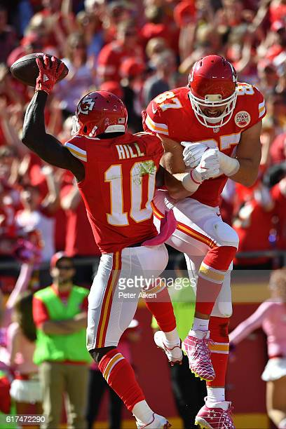 Wide receiver Tyreek Hill of the Kansas City Chiefs celebrates after a touchdown with teammate Travis Kelce at Arrowhead Stadium during the second...