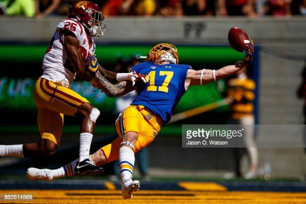 Wide receiver Vic Wharton III of the California Golden Bears reaches for but is unable to catch a pass in the end zone in front of cornerback Jack...