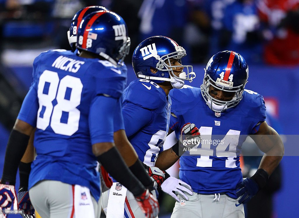 Wide receiver Victor Cruz #80 of the New York Giants celebrates with a salsa dance after scoring a touchdown in the second quarter as his teammates running back Ahmad Bradshaw #44, wide receiver Rueben Randle #82 and wide receiver Hakeem Nicks #88 look on against the Green Bay Packers at MetLife Stadium on November 25, 2012 in East Rutherford, New Jersey.
