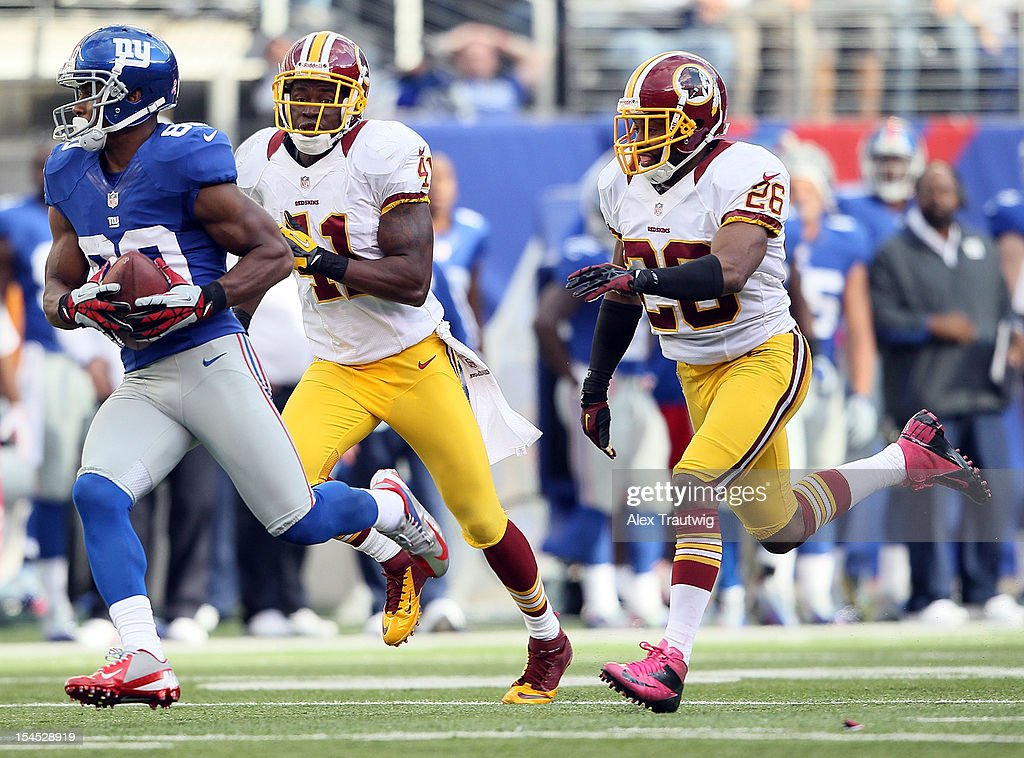 Wide receiver Victor Cruz #80 of the New York Giants makes a catch and runs it in for the game winning touchdown against the Washington Redskins during their game at MetLife Stadium on October 21, 2012 in East Rutherford, New Jersey.