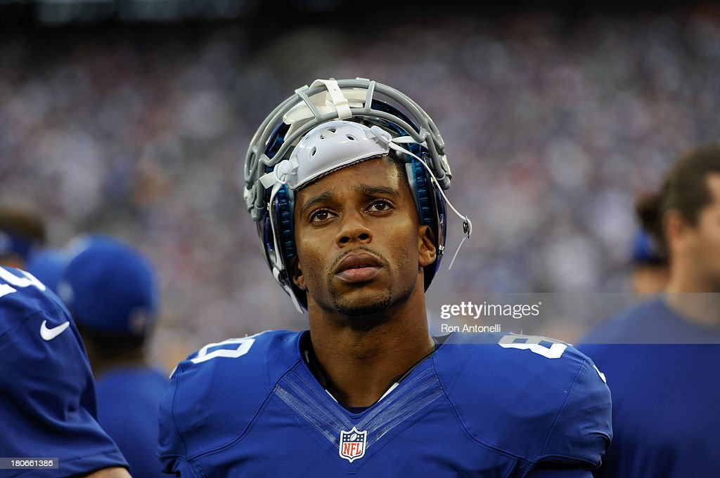 Wide receiver <a gi-track='captionPersonalityLinkClicked' href=/galleries/search?phrase=Victor+Cruz+-+American+Football+Player&family=editorial&specificpeople=8736842 ng-click='$event.stopPropagation()'>Victor Cruz</a> #80 of the New York Giants on the bench during the 2nd half of the Denver Broncos 41-23 win over the New York Giants at MetLife Stadium on September 15, 2013 in East Rutherford, New Jersey.