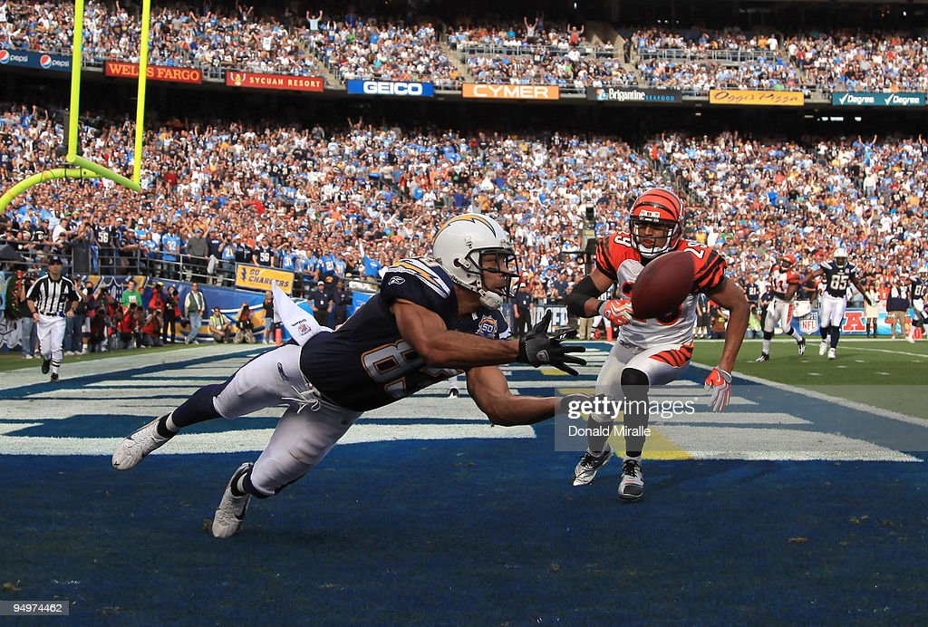 Wide Receiver Vincent Jackson of the San Diego Chargers catches a touchdown pass in the 1st half against Leon Hall of Cincinnati Bengals during the...