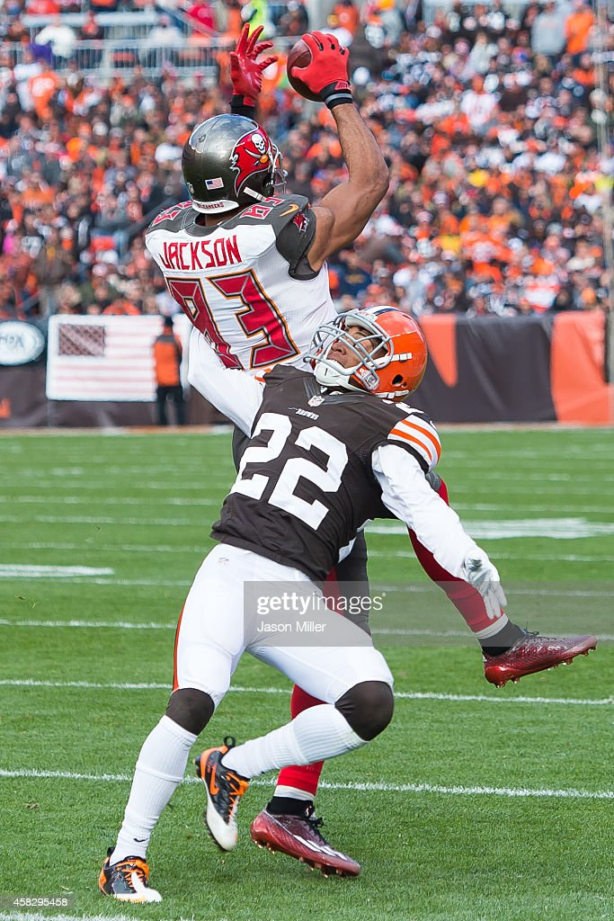 Wide receiver Vincent Jackson of the Tampa Bay Buccaneers catches a pass under pressure from cornerback Buster Skrine of the Cleveland Browns during...