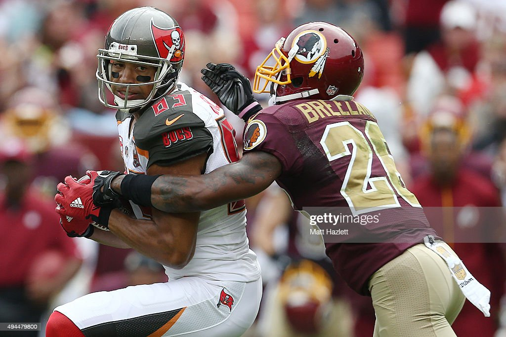 Wide receiver Vincent Jackson of the Tampa Bay Buccaneers catches a pass while cornerback Bashaud Breeland of the Washington Redskins defends in the...