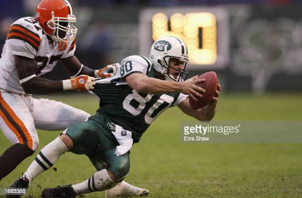 Wide Receiver Wayne Chrebet of the New York Jets is taken down by Defensive Back Anthony Henry of the Cleveland Browns during the NFL game at Giant...