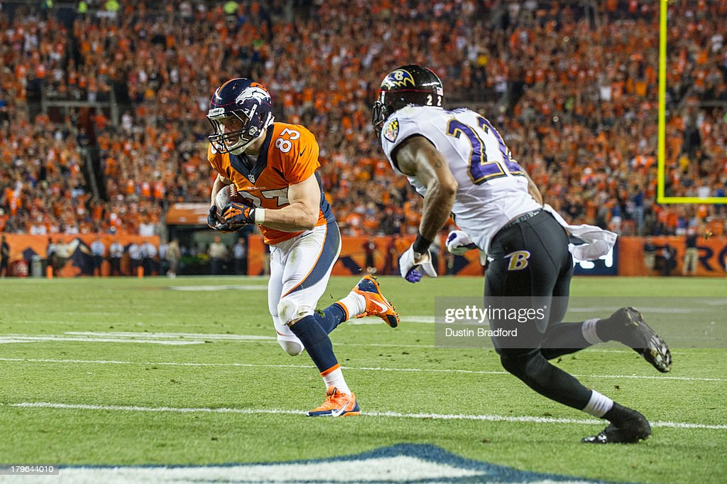 Wide receiver Wes Welker #83 of Denver Broncos turns toward the end zone for a third period touchdown against the Baltimore Ravens during the game at Sports Authority Field at Mile High on September 5, 2013 in Denver Colorado.