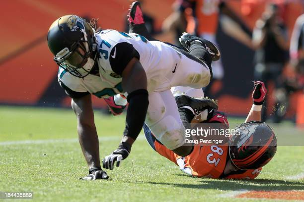 Wide receiver Wes Welker of the Denver Broncos makes a touchdown pass reception against strong safety John Cyprien of the Jacksonville Jaguars at...