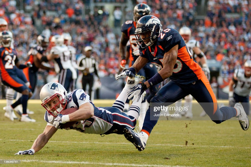 Wide receiver <a gi-track='captionPersonalityLinkClicked' href=/galleries/search?phrase=Wes+Welker&family=editorial&specificpeople=236127 ng-click='$event.stopPropagation()'>Wes Welker</a> #83 of the New England Patriots is downed at the one yard line by cornerback Chris Harris #25 of the Denver Broncos during the second quarter at Sports Authority Field at Mile High on December 18, 2011 in Denver, Colorado. The Broncos defeated the Bears 13-10 in overtime.