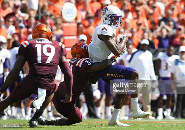 Wide receiver Zay Jones of the East Carolina Pirates makes a reception against the Virginia Tech Hokies in the second half at Lane Stadium on...