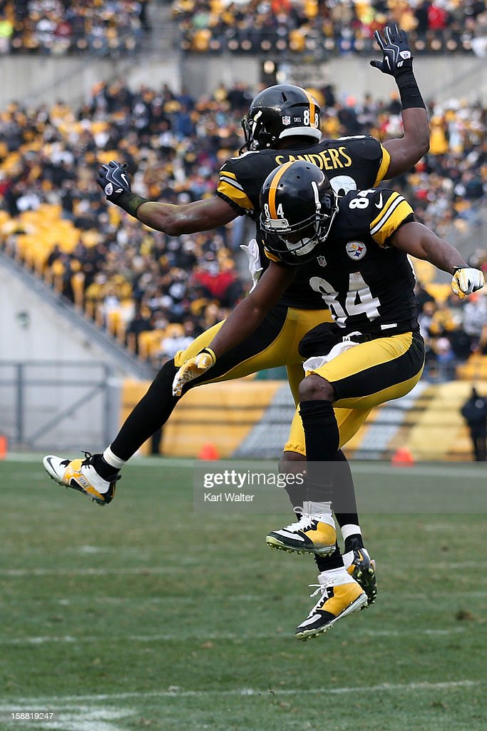 Wide receivers Antonio Brown #84 and <a gi-track='captionPersonalityLinkClicked' href=/galleries/search?phrase=Emmanuel+Sanders&family=editorial&specificpeople=5798683 ng-click='$event.stopPropagation()'>Emmanuel Sanders</a> #88 of the Pittsburgh Steelers celebrate after Brown's touchdown during the third quarter against the Cleveland Browns at Heinz Field on December 30, 2012 in Pittsburgh, Pennsylvania.