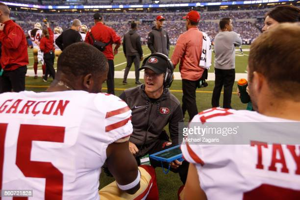 Wide Receivers/Passing Game Specialist Mike LaFleur of the San Francisco 49ers talks with Pierre Garcon and Trent Taylor on the sideline during the...