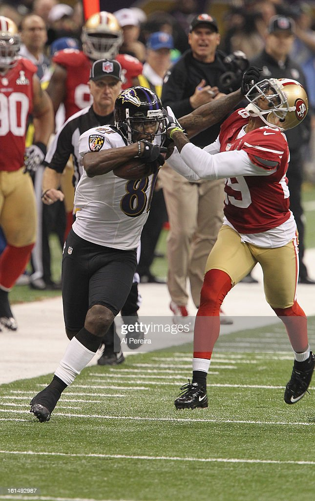 Wide Reciever Anquan Boldin #81 of the Baltimore Ravens has a long gain and fights off Cornerback Chris Culliver #29 of the San Francisco 49ers during Super Bowl XLVII at Mercedes-Benz Superdome on February 3, 2013 in New Orleans, Louisiana.