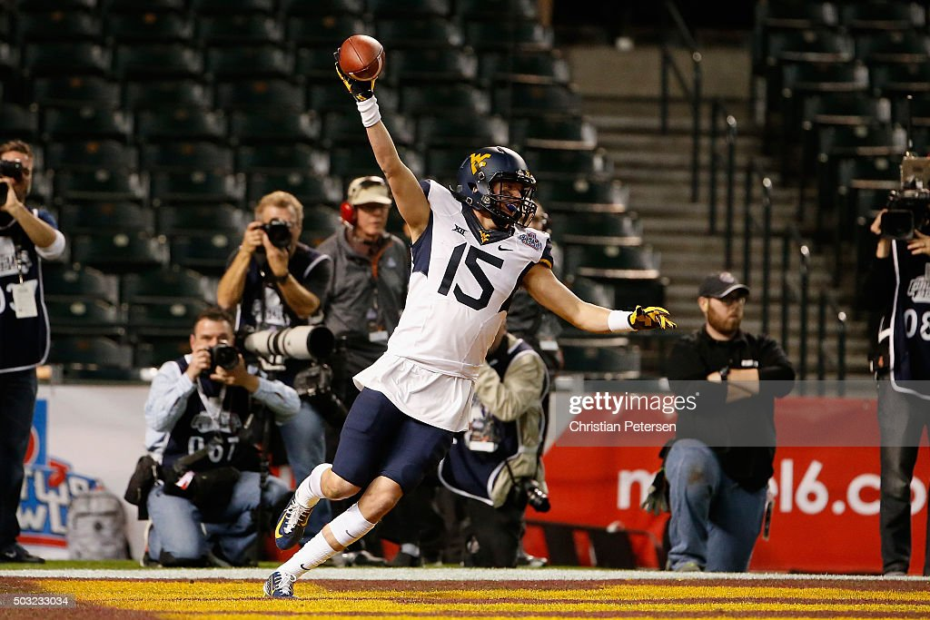Wide reciever David Sills of the West Virginia Mountaineers celebrates after catching 15 yard touchdown reception against the Arizona State Sun...