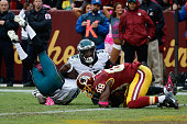 Wide reciever Pierre Garcon of the Washington Redskins catches the game winning touchdown pass in front of Walter Thurmond and Eric Rowe of the...