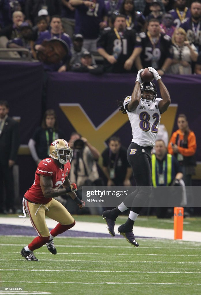 Wide Reciever Torrey Smith #82 of the Baltimore Ravens has a long gain against the San Francisco 49ers during Super Bowl XLVII at Mercedes-Benz Superdome on February 3, 2013 in New Orleans, Louisiana.