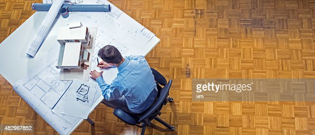 Wide shot of architect working in office