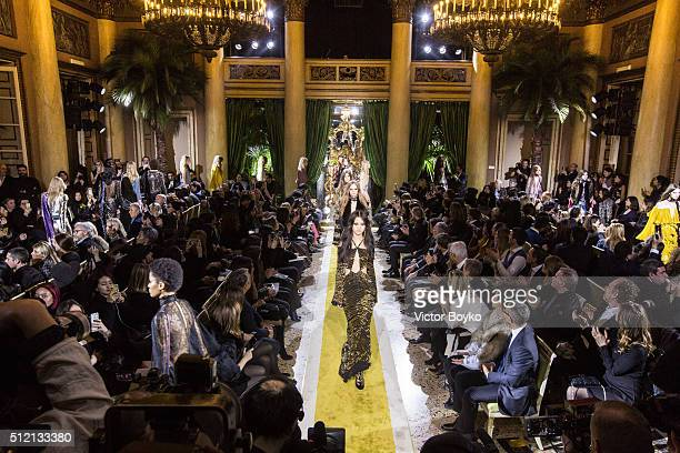 A wide shot of models walks the runway during the finale at the Roberto Cavalli show during Milan Fashion Week Fall/Winter 2016/17 on February 24...