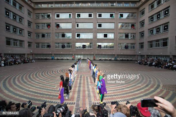 A wide shot of the models walking the runway during the finale of the Kenzo Menswear Spring/Summer 2018 show as part of Paris Fashion Week on June 25...