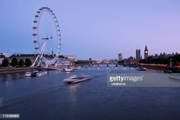 Wide side shot of London at dusk with the London eye