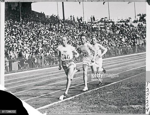 Wide Sweden leading Willie Ritola Finland and Paavo Nurmi Finland in early stages of 5000 meters