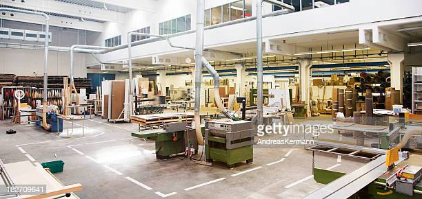 Wide view of a carpentry company with equipment and wood