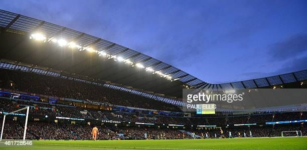 A wide view shows the English Premier League football match between Manchester City and Arsenal at the Etihad Stadium in Manchester north west...