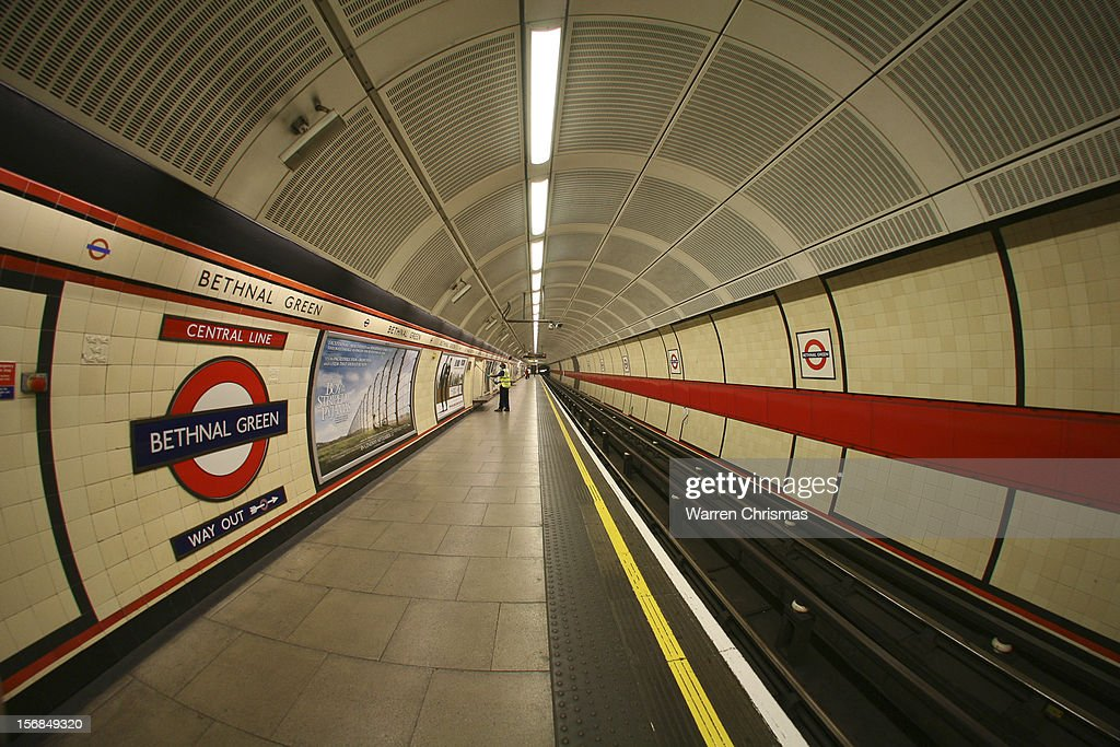 A wide-angle shot of a Central Line platform on Bethnal Green Underground station in London.