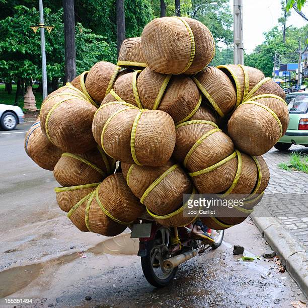 Wide-load of woven baskets on motorcycle in Cambodia