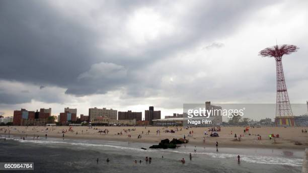 A widescreen view of a cloudy day in Coney Island.