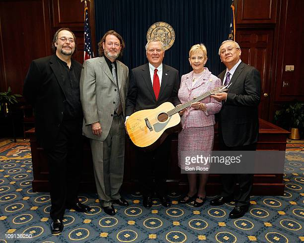 Widespread Panic's Todd Nance and John Bell pose with Governor Nathan Deal First Lady Sandra Deal and Widespread Panic's Domingo S Ortiz before a...