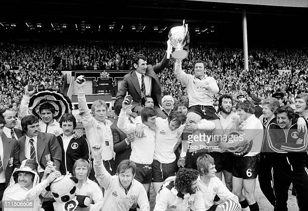 Widnes coach Vince Karalius celebrates wth his team after their victory over Warrington in the Rugby League Challenge Cup Final at Wembley Stadium in...