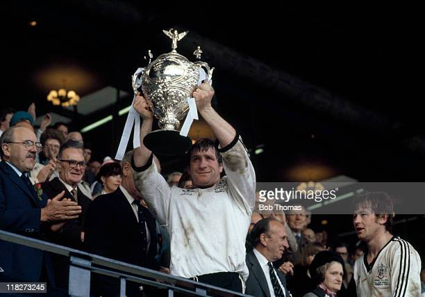 Widnes rugby league captain Mick Adams holds aloft the Challenge Cup after their victory over Hull Kingston Rovers in the Rugby League Challenge Cup...