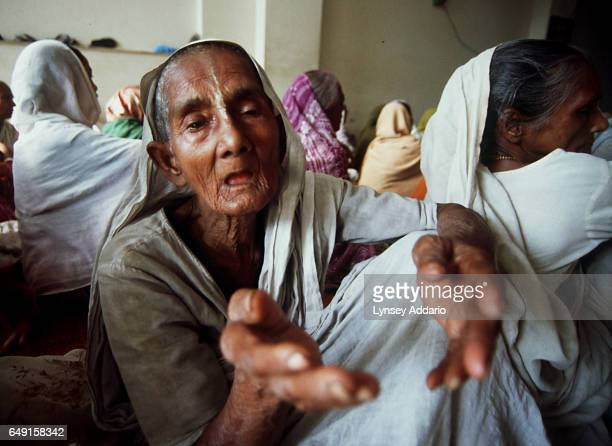 A widow begs for money during an afternoon chanting session at an ashram in Vrindavan Uttar Pradesh India on March 4 2000 Most widows in India live...