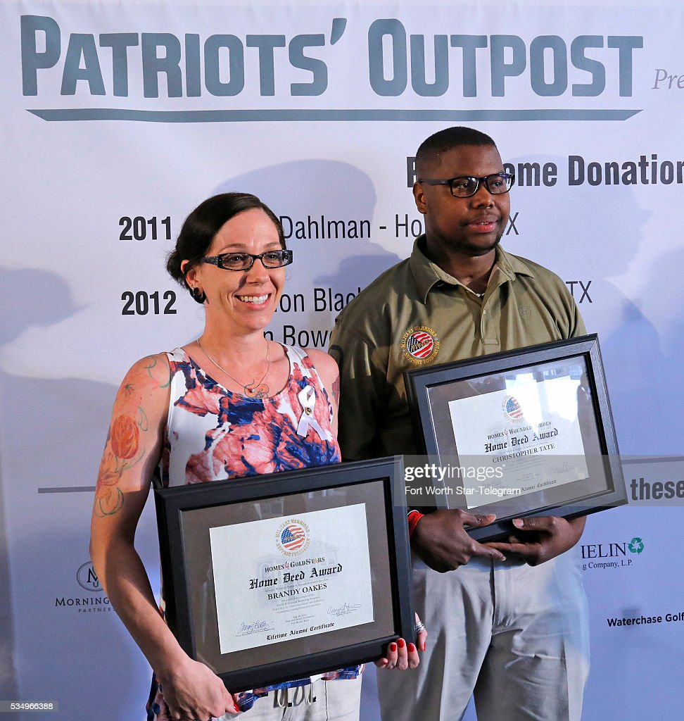 Widow Brandy Oakes and Purple Heart recipient Christopher Tate are each awarded new homes by the Military Warriors Support Foundation during the third day of the Dean & DeLuca Invitational at Colonial Country Club in Fort Worth, Texas, on Saturday, May 28, 2016.