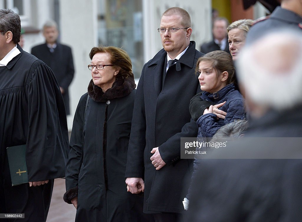 Widow Brigitte Struck an her son Niklas stand in front of the church after a memorial service for former German Defence Minister Peter Struck on January 3, 2013 in Uelzen, Germany. Struck was a leading member of the German Social Democrats (SPD) and died in December following a heart attack.