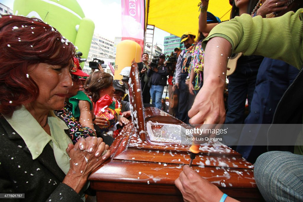 A widow cries in front of a coffin during Entierro Del Pepino fest as part of canival closing celebration on Marcha 9, 2014 in La Paz, Bolivia. (Photo by Jose Luis Quintana/LatinContent/Getty Images).
