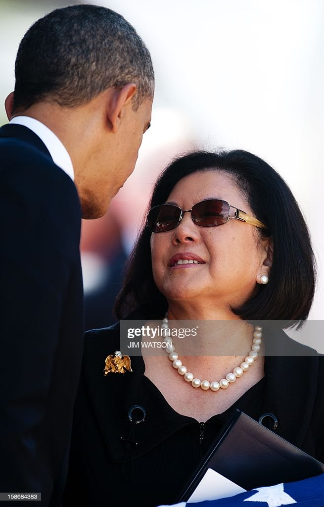 Widow Irene Hirano Inouye (R) speaks with US President Barack Obama (L) as they attend the memorial service for the late Senator Daniel Inouye at the National Memorial Cemetery of the Pacific in Honolulu, Hawaii, December 23, 2012. AFP Photo/Jim WATSON