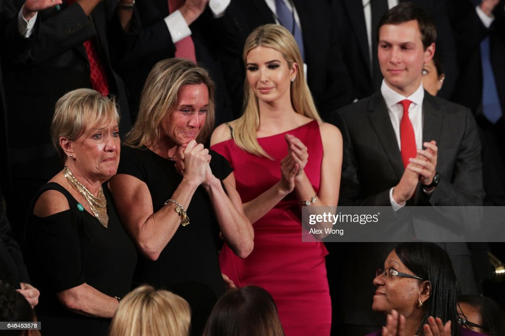 Widow of Fallen Navy Seal, Senior Chief William Owens, Carryn Owens (2ndL), Ivanka Trump and White House Senior Advisor to the President for Strategic Planning Jared Kushner attend a joint session of the U.S. Congress with U.S. President Donald Trump on February 28, 2017 in the House chamber of the U.S. Capitol in Washington, DC. Trump's first address to Congress focused on national security, tax and regulatory reform, the economy, and healthcare.