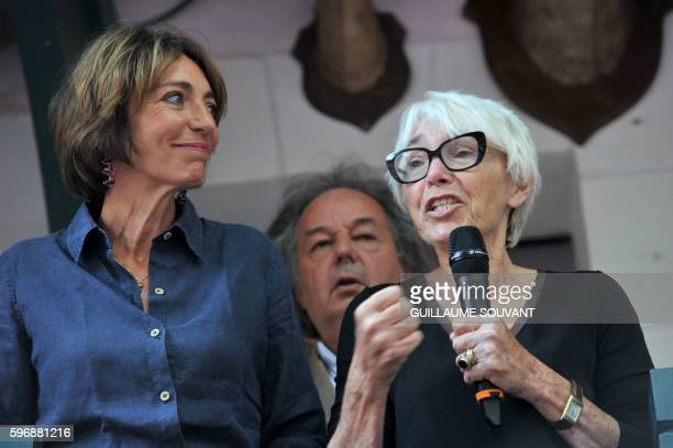 Widow of French former Prime minister Michel Rocard Sylvie Pellissier talks next to French minister of health Marisole Touraine and French writer...