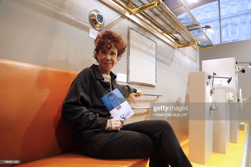 Widow of French founder of the charitable organisation 'Les Restos du Coeur' Coluche, Veronique Colucci, poses on December 14, 2012 in Paris during the presentation of a SNCF auction whose proceeds will go to 'Les Restos du Coeur' (Restaurants of the Heart). France national rail company SNCF is set to offer more than 150 vintage items of the Z6100 series trains from the 1960's.