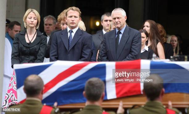 Widow of Major Sean Birchall of the 1st Battalion Welsh Guards Joanna Birchall watches her husbands coffin being carried from the Guards Chapel...