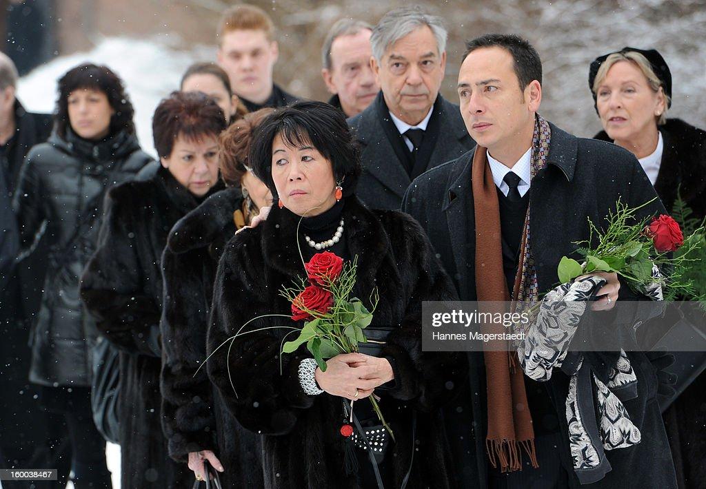 Widow Soo Leng-Kuchenreuther, Thomas Kuchenreuther (Brother of Steffen Kuchenreuther) and Jeremy Wilson (R-son of Steffen Kuchenreuther) attend the memorial service for Steffen Kuchenreuther at the Waldfriedhof on January 25, 2013 in Munich, Germany.